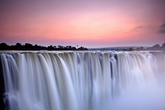 Sonnenuntergang an den Victoria Falls in Simbabwe